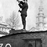 English violinist Albert Sammons plays atop a tank in Trafalgar Square, 1916