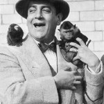 Italian tenor Tito Schipa with his pet monkeys