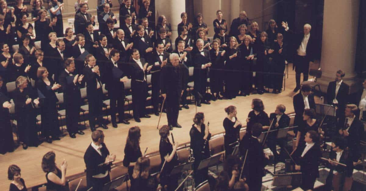 John Gardner in front of choir