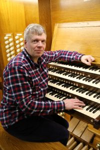 Michael Brough at the console of the organ in Holy Trinity