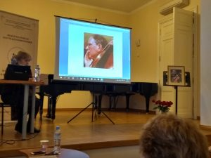 Photo of the stage and screen with Ivaskhin's portrait at a conference presentation on Ivashkin's work